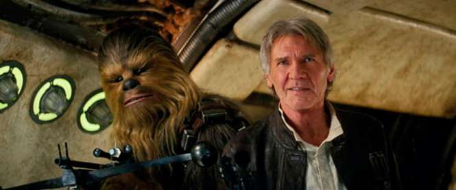 """Peter Mayhew, as Chewbacca, and Harrison Ford in """"Star Wars: The Awakening of the Force""""."""