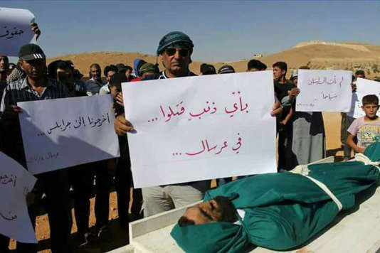 Lors des funérailles des Syriens morts après leur interpellation, le 4 juillet à Ersal.