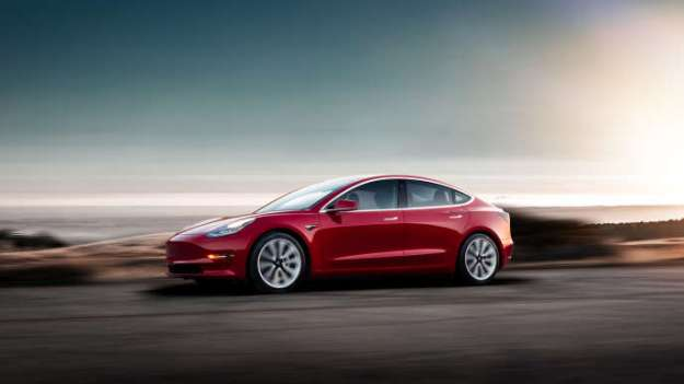 The Tesla Model 3 offers a deliberately sober silhouette.