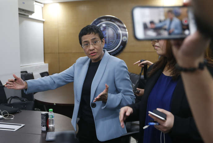 Maria Ressa, editor-in-chief of a news website critical of the Philippine president, was arrested in Manila on February 13, 2019.