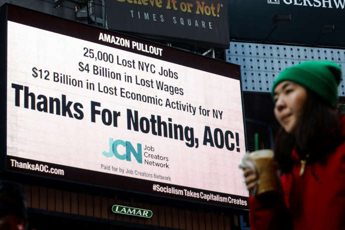 "In New York, February 21, a sign denouncing the role of Alexandria Ocasio-Cortez, ""AOC"", in the abandonment of the proposed headquarters of Amazon in Queens."