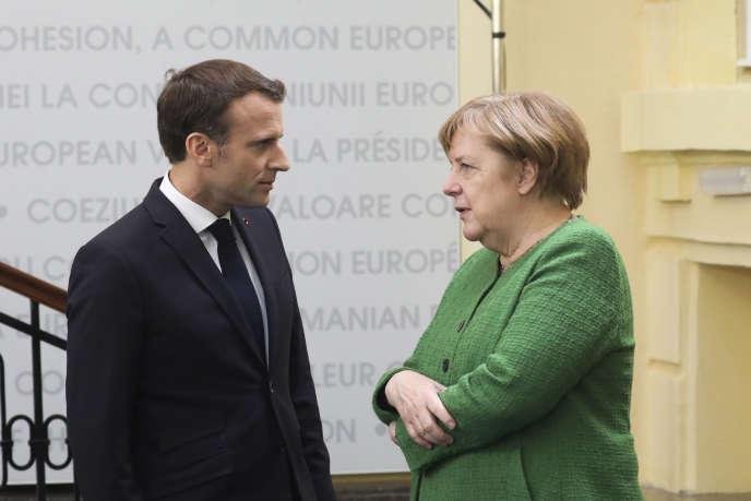 Emmanuel Macron and Angela Merkel in Romania, May 9.