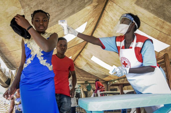 The temperature of people from the DRC is being measured for Ebola symptoms at the Mpondwe border crossing with Congo in western Uganda on June 14, 2019.