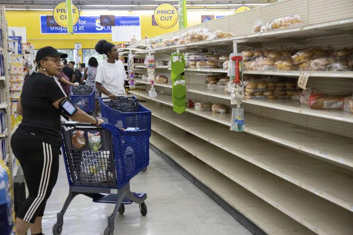 Residents of Freeport, Bahamas, shop for Hurricane Dorian.