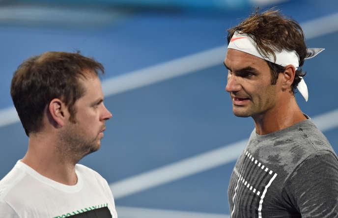 Roger Federer and Severin Lüthi on the sidelines of the 2017 Australian Open.
