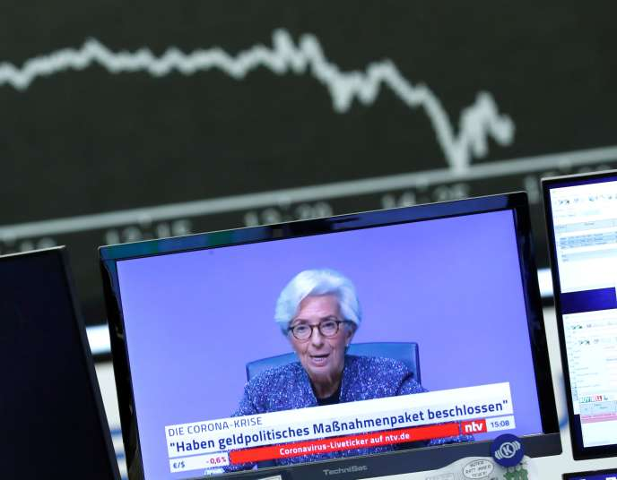 A press conference by Christine Lagarde, President of the ECB, is viewed on the Frankfurt Stock Exchange in Germany on March 12.