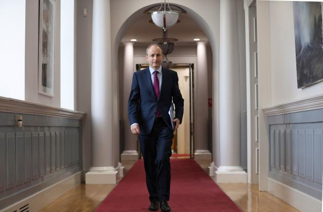 Irish Prime Minister Micheál Martin holds a copy of the report of the Irish Commission of Inquiry into 'Homes for Mothers and Babies' in Dublin on January 12, 2021.