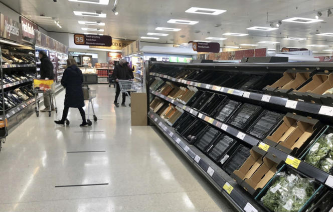 Almost empty shelves in a Sainsbury's supermarket in Belfast (Northern Ireland) on January 11.