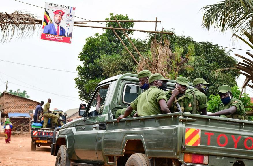 Security forces on patrol around Bobi Wine's home in Kampala's Magere neighborhood on January 16.