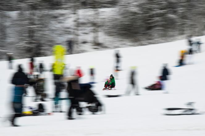 Swedes take advantage of the snow to toboggan in Golfangarna, in the town of Sundbyberg, near Stockholm, on January 16.