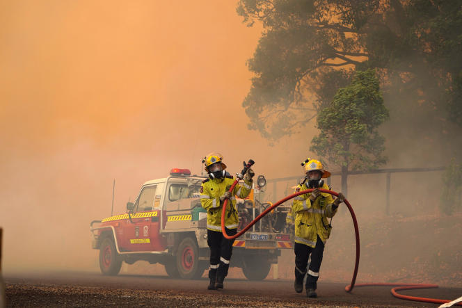 Firefighters during a blaze near Wooroloo, northeast of Perth, Australia on February 2.