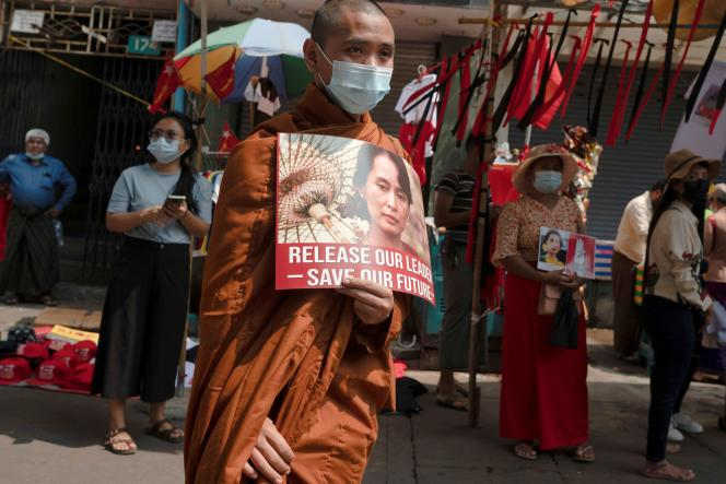 A Buddhist monk participates in the demonstration calling for the release of Aung San Suu Kyi in Yangon, Burma, on February 18.