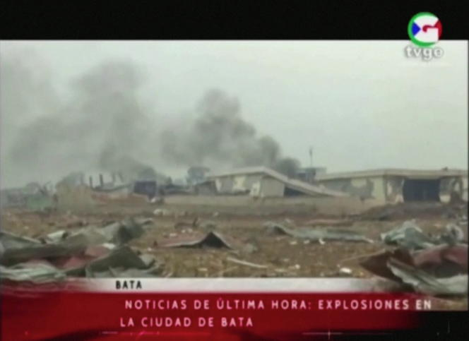 On the first images broadcast by state television appear ruined buildings in front of plumes of black smoke, in Bata, Sunday March 7.