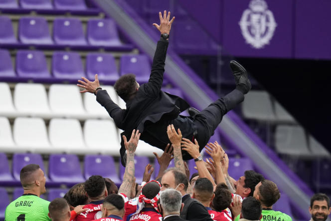 Colchoneros head coach Diego Simeone is carried by his players at the end of the La Liga soccer match between Atlético de Madrid and Valladolid at the José-Zorrilla stadium in Valladolid (Spain) on May 22, 2021.