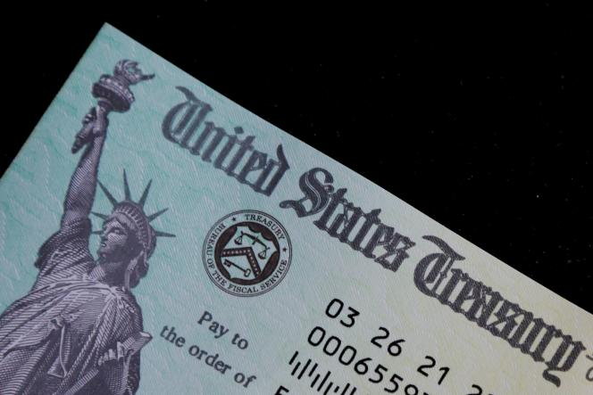 Un chèque du plan de relance américain pour aider les familles à faire face à la pandémie de Covid-19.