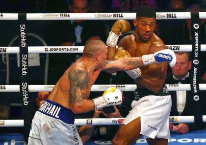 Anthony Joshua palms over his world crown to Oleksandr Usyk