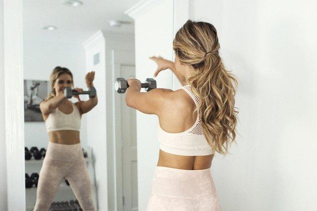 woman doing dumbbell exercises