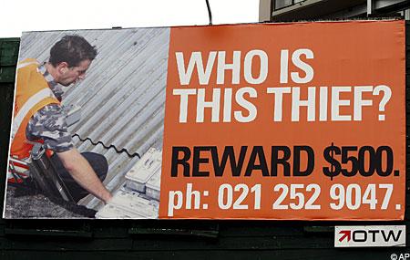 Thief photo on billboard