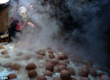 Hundreds of eggs being boiled in boys' urine
