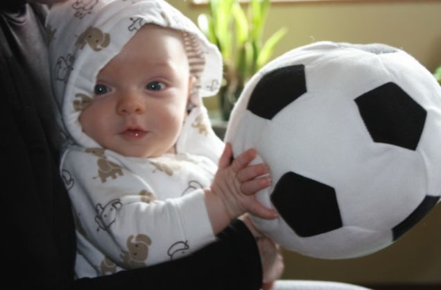 Future star: Baerke van der Meij poses with a football that is half the size of him