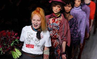 Designer Vivienne Westwood leads her models down the catwalk