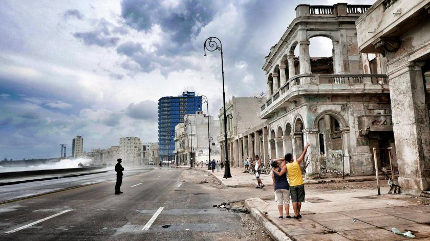 Cubans look at the damage caused by the storm at Havana's Malecón, three days after Hurricane Irma passed over Cuba.