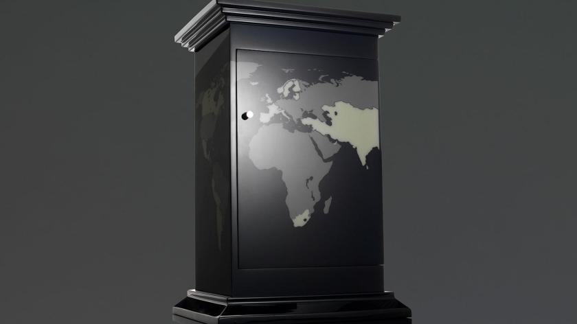 The humidor is decorated with a world map. Any country that's represented in the cigar collection glows in the dark on the surface of the cabinet.