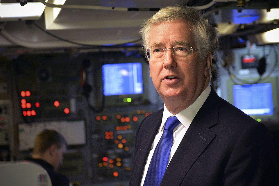 Defence secretary Michael Fallon in the control room on board Vanguard-class submarine HMS Vigilant.