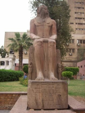 another decoration of the Arab republic parks, the statue of  a native African pharaoh completely defaced
