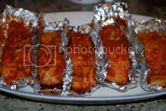 Salmon being marinated with spices for grilling by Arun Shanbhag
