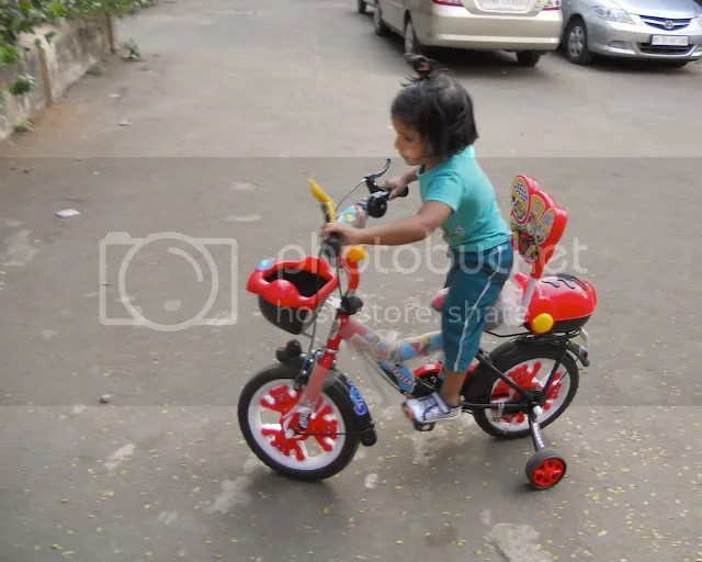 Pics of Meera riding a Bicycle by Arun Shanbhag