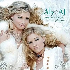 "Cover of Aly and AJ's ""Acoustic Hearts of Winter,"" which depicts two blond women relaxing in a wintry environment."
