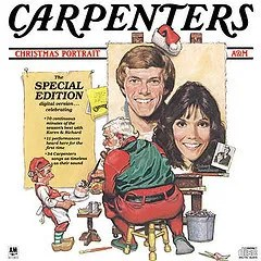 "Cover of The Carpenters' ""Christmas Portrait,"" depicting an illustrated image of Santa Claus paiting a portrait of Richard and Karen Carpenter as an elf holds a paint pallette."