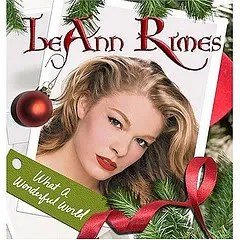 "Cover of LeAnn Rimes' album ""What a Wonderful World,"" which depicts a photograph of the singer surrounded by holiday trimmings."