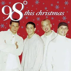 "Cover of 98 Degrees' album ""This Christmas,"" depicting four young men standing in front of a festive red background."