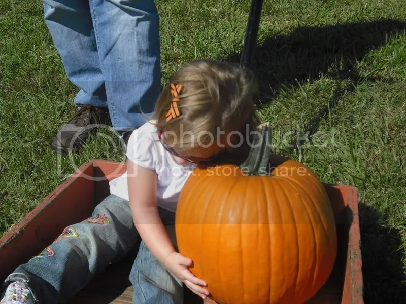 Giving her pumpkin a hug!
