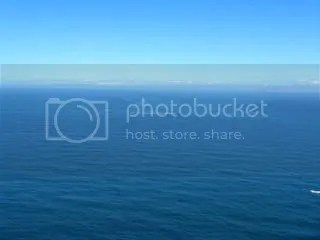 Off Cape Point, currents from the Indian and Atlantic Oceans meet.  (Can you see the waves breaking at sea?)