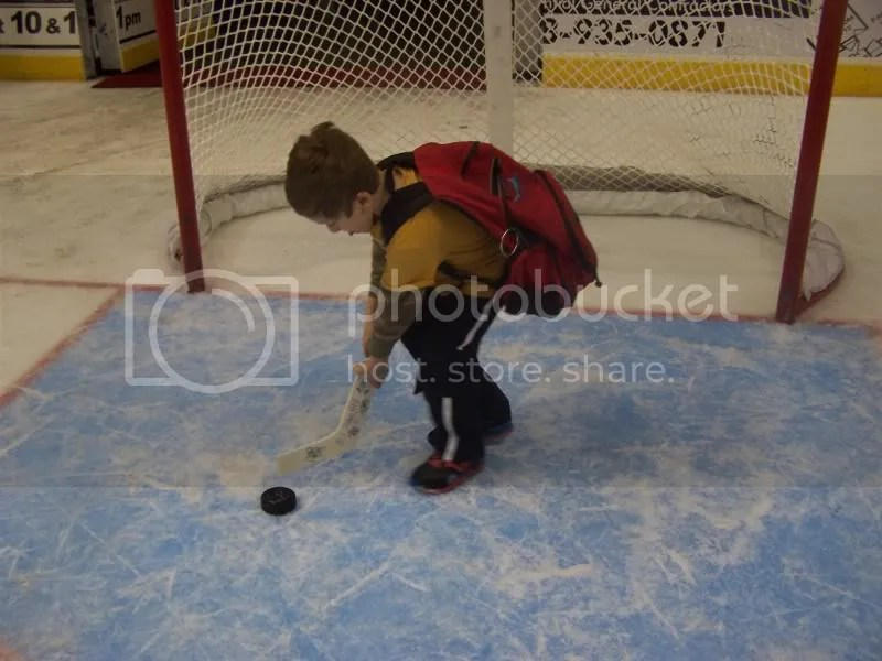 playing hockey...oh, am I in for it with this kid..