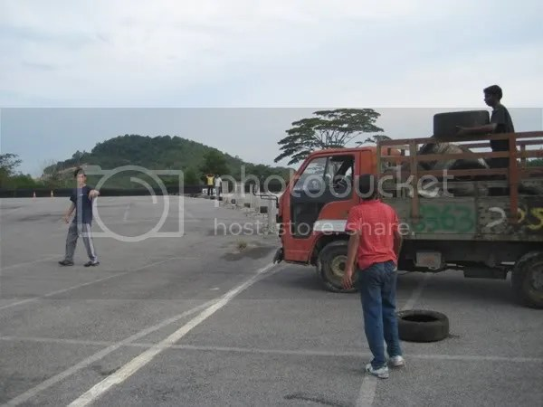 Yoong directing the workers where to place the tires