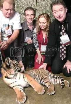 A good editor is always willing to confront dangerous situations - such as petting a sedated tiger cub
