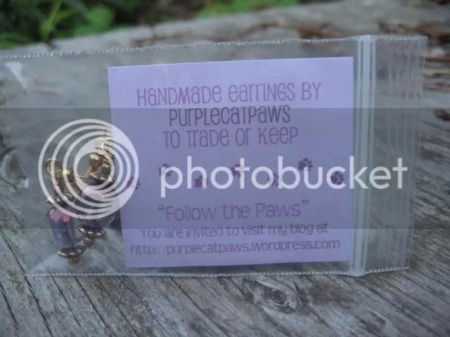 Purplecatpaws signature earring geoswag