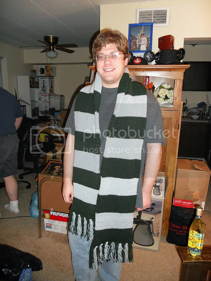 The happy owner with the scarf on.