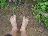 my feet in the area that I'm removing grass
