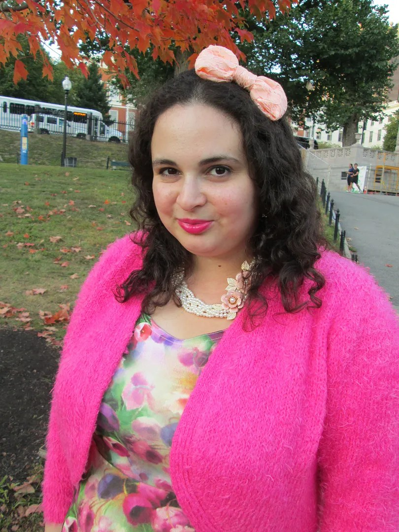 plus size outfit pink fuzzy sweater and multicolored watercolor floral skater dress