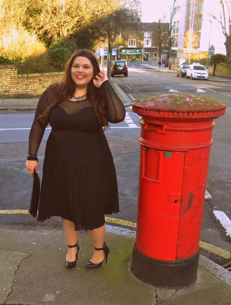 plus size glamorous all-black outfit with sheer top and black skirt