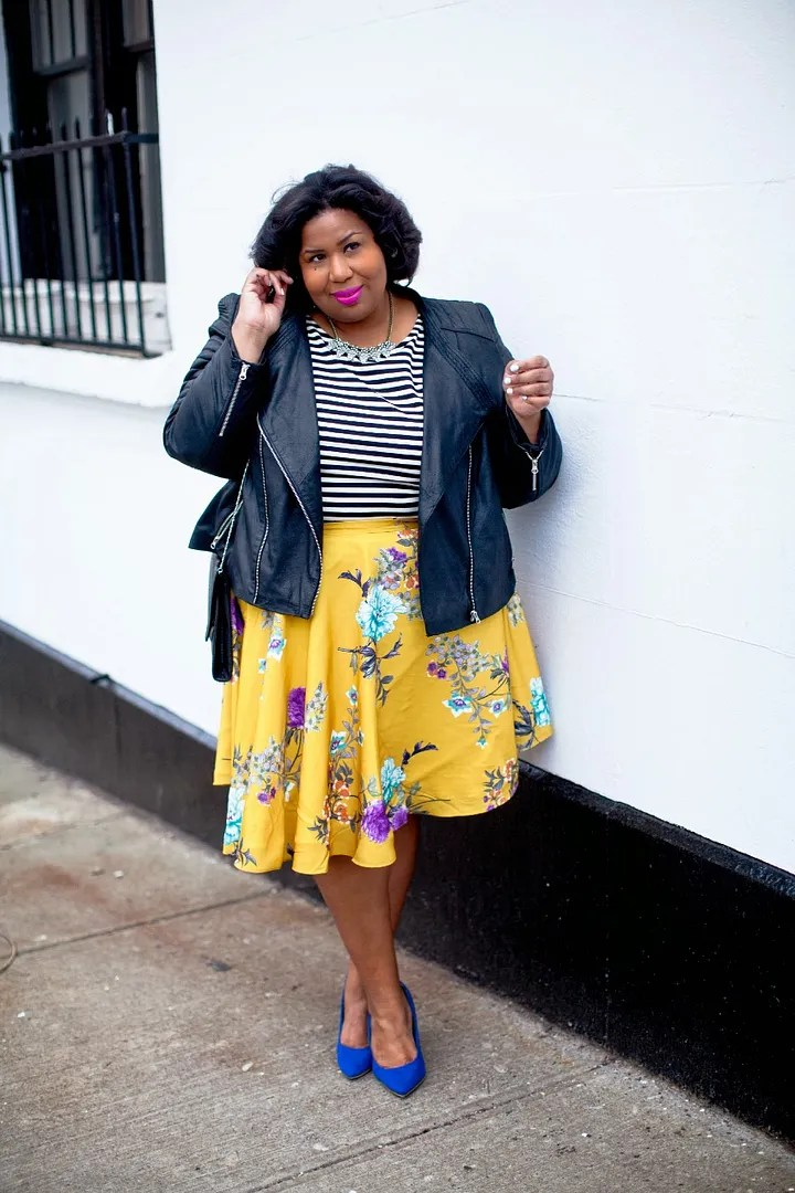 awesome spring-y plus size outfit with striped shirt, leather moto jacket, and yellow floral skirt