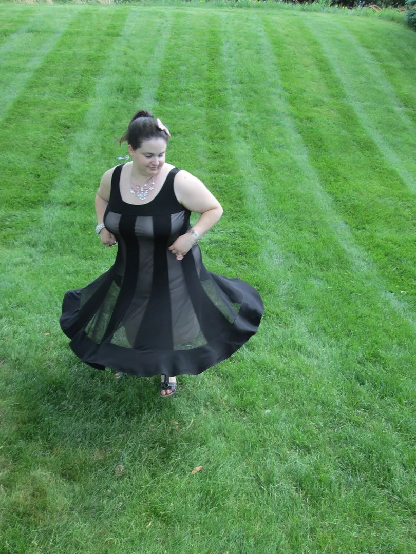 twirling in black and beige striped dress