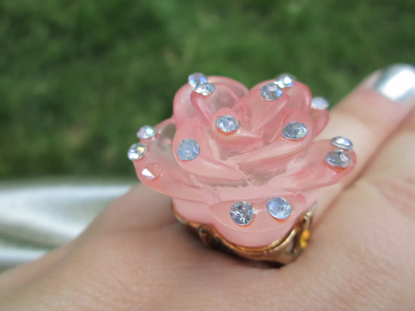 close-up of pink rose statement ring with rhinestones