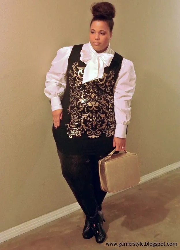 plus size woman wearing white shirt with pussybow, black and gold damask foil vest and black skirt