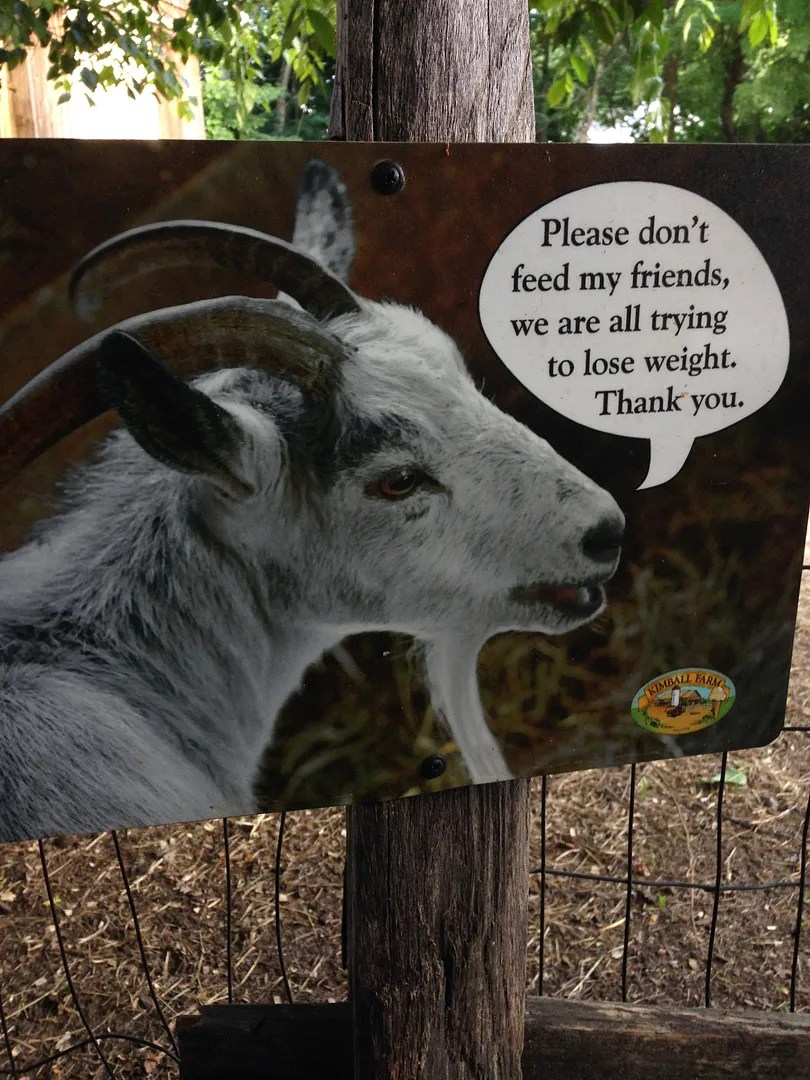sign with picture of goat saying
